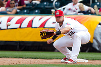 Matthew Adams (25) of the Springfield Cardinals reaches for a throw to first during a game against the Midland RockHounds on April 19, 2011 at Hammons Field in Springfield, Missouri.  Photo By David Welker/Four Seam Images