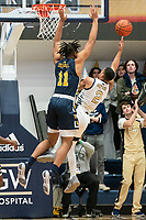 WASHINGTON, DC - FEBRUARY 22: Ed Croswell #11 of La Salle looms over Armel Potter #2 of George Washington s he takes a shot during a game between La Salle and George Washington at Charles E Smith Center on February 22, 2020 in Washington, DC.