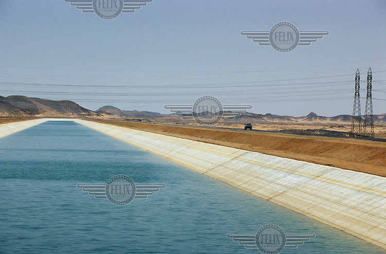 The Sheikh Zayed Canal in the Western Desert, which diverts water over 550 kilometres from Lake Nasser to create and irrigate farmland in otherwise arid areas.  The transfer canal is part of the Toshka project, an engineering venture inaugurated in 1997 whose goal is to reclaim over 500,000 acres of desert..