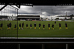 Visiting players going through their pre-match warm up on the pitch at Borough Briggs, home to Elgin City, on the day they played SPFL2 newcomers Edinburgh City. Elgin City were a former Highland League club who were elected to the Scottish League in 2000, whereas Edinburgh City became the first club to gain promotion to the League by winning the Lowland League title and subsequent play-off matches in 2015-16. This match, Edinburgh City's first away Scottish League match since 1949, ended in a 3-0 defeat, watched by a crowd of 610.