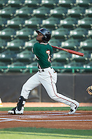 Mason Davis (7) of the Greensboro Grasshoppers follows through on his swing against the Hickory Crawdads at L.P. Frans Stadium on May 6, 2015 in Hickory, North Carolina.  The Crawdads defeated the Grasshoppers 1-0.  (Brian Westerholt/Four Seam Images)