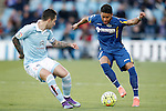 Getafe's Wanderson (r) and Celta de Vigo's Hugo Mallo during La Liga match. February 27,2016. (ALTERPHOTOS/Acero)