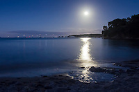 Moonlit view from Middle Beach towards Old Harry Rocks. Studland, Dorset, UK.