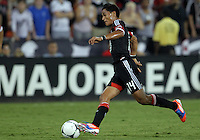 WASHINGTON, DC. - AUGUST 22, 2012:  Andy Najar (14) of DC United moves up field against the Chicago Fire during an MLS match at RFK Stadium, in Washington DC,  on August 22. United won 4-2.