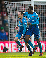 Hector Bellerin of Arsenal celebrates scoring the opening goal of the match with Danny Welbeck of Arsenal during the Premier League match between Bournemouth and Arsenal at the Goldsands Stadium, Bournemouth, England on 14 January 2018. Photo by Andy Rowland.