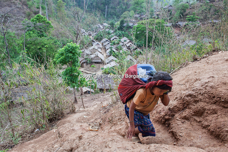 The girl is carrying  the water to her villagge accross the numerous hills of this Jungle. Her village is inhabited by 10,000 IDPs.