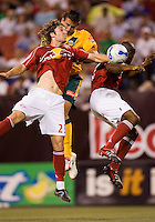 Red Bulls defender (23) Jeff Parke and defender (2) Marvell Wynne go up for a header against LA Galaxy forward (21) Alan Gordon. The New York Red Bulls defeated the LA Galaxy 2-1 in an MLS regular season match at Giants Stadium, East Rutherford, NJ, June 17, 2006.
