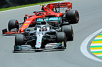 16th November 2019; Autodromo Jose Carlos Pace, Sao Paulo, Brazil; Formula One Brazil Grand Prix, Qualifying Day; Lewis Hamilton (GBR) Mercedes AMG F1 W10 and Charles Leclerc (MON) Scuderia Ferrari SF90 - Editorial Use