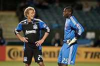 Steven Lenhart (24) chats with Sean Johnson (r25) between plays. The Chicago Fire defeated the San Jose Earthquakes after going 5-4 on penalty kicks, after a 2-2 score in regulation during the US Open Cup at Buck Shaw Stadium in Santa Clara, California on May 24th, 2011.