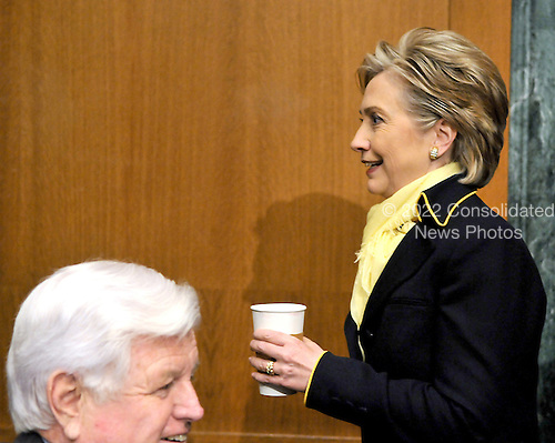 "Washington, DC - April 8, 2008 -- United States Senator Hillary Rodham Clinton (Democrat of New York), left, walks past United States Senator Edward M. ""Ted"" Kennedy (Democrat of Massachusetts), lower left, without acknowledging him prior to hearing the testimony of General David Petraeus and Ambassador Ryan Crocker before the United States Senate Armed Services Committee on the situation and progress in Iraq in Washington, D.C. on Tuesday, April 8, 2008..Credit: Ron Sachs / CNP"