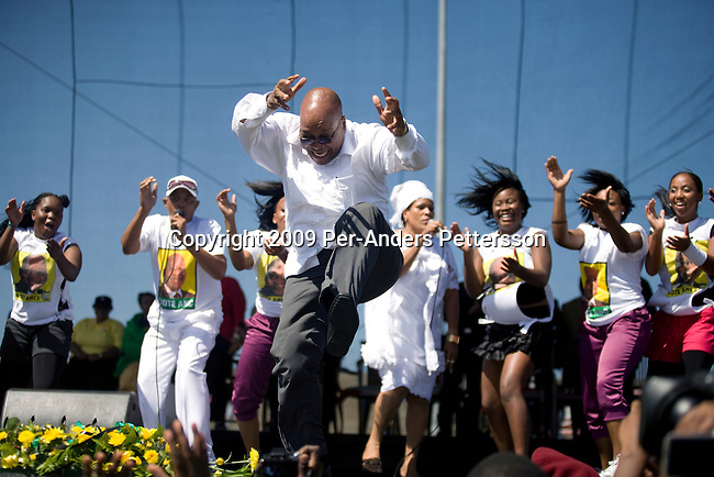 KHAYELITSHA, SOUTH AFRICA FEBRUARY 22: ANC president Jacob Zuma sings and dances after a speech at a rally on February 22, 2009 in Khayelitsha a poor township outside Cape Town, South Africa. Mr. Zuma went for a door-to-door campaign to drum up support for his party ahead of the elections. Mr. Zuma was recently cleared of several fraud and corruption charges and he is expected to win the general election on April 22, and become South Africa?s third democratic elected president. (Photo by Per-Anders Pettersson/Getty Images)..