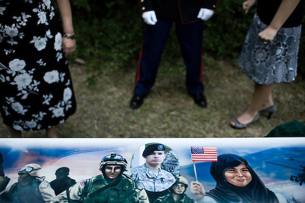 July 3, 2008. Pinetown, NC.. The funeral of Spc. Joel A. Taylor, assigned to the 1st Squadron, 3rd Armored Cavalry Regiment, Fort Hood, Texas; died June 25 in Mosul, Iraq, of wounds sustained when his vehicle encountered an improvised explosive device on June 24, 2008. He was 20.. A memorial to Spc. Taylor shows a photograph of him, as well as images from Iraq, including soldiers and Iraqi citizens.