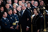WASHINGTON, DC - DECEMBER 3 : Former president George W. Bush and wife Laura Bush depart after seeing former president George H.W. Bush as he lies in State at the U.S. Capitol Rotunda on Capitol Hill on Monday, Dec. 03, 2018 in Washington, DC. (Photo by Jabin Botsford/Pool)