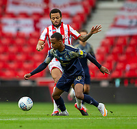 4th July 2020; Bet365 Stadium, Stoke, Staffordshire, England; English Championship Football, Stoke City versus Barnsley; Elliot Simoes of Barnsley is tackled by Julien Ngoy of Stoke City