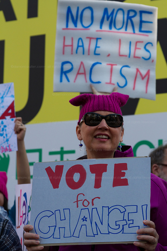 "A woman holds a sign that reads, ""Vote for change"" at the Vote Out the Scandal rally at Hachiko Square, Shibuya, Tokyo, Japan. Sunday November 5th 2017. Timed to coincide with President Trumps visit to Japan, About 120 Americans living in Japan and some local Japanese  protested together from 2pm to 4pm to encourage US citizens to register to vote in future elections and call on the US government to honour it responsibilities to the American people,."