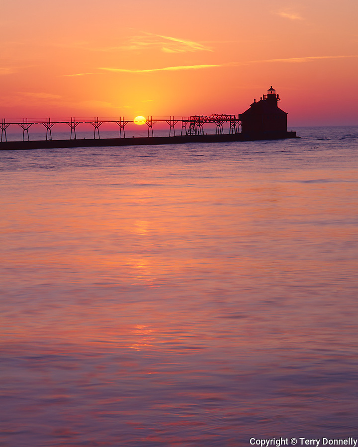 Door County, WI: Sturgeion Bay Canal North Pierhead Lighthouse silhouetted by Lake Michigan sunrise