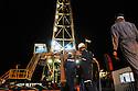 Iraq 2008.Workers in the refinery of Germian by night     Irak 2008. Ouvriers de la raffinerie de Germian , la nuit