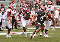 NWA Democrat-Gazette/ANDY SHUPE<br /> Arkansas quarterback John Stephen Jones (9) rolls out to pass Saturday, April 6, 2019, during the Razorbacks' spring game in Razorback Stadium in Fayetteville. Visit nwadg.com/photos to see more photographs from the game.