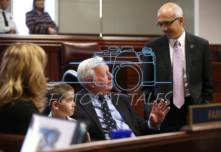 Nevada Sen. Mo Denis, D-Las Vegas, right, talks with former Sen. Bill O'Donnell and his grandson on Senate floor debate at the Legislative Building, in Carson City, Nev., on Friday, Feb. 20, 2015. <br /> Photo by Cathleen Allison