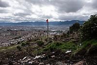 BOGOTA - COLOMBIA, 17-05-2020: Bandera roja, símbolo del hambre en tiempos de pandemia, izada sobre los escombros de las viviendas desalojadas y tumbadas por la retroexcavadora. Mas de 200 familias terminan el proceso de desalojo en el predio La Estancia al sur de Bogotá quedando sin ninguna ayuda ni un techo donde vivir durante la cuarentena total en el territorio colombiano causada por la pandemia  del Coronavirus, COVID-19. / Red flag, symbol of hunger in times of pandemic, hoisted over the rubble of the evicted houses and knocked down by the backhoe. More than 200 families are evicted from La Estancia farm at south of Bogota city and they left withoput any help and shelter to live during total quarantine in Colombian territory caused by the Coronavirus pandemic, COVID-19. Photo: VizzorImage / Mariano Vimos / Cont