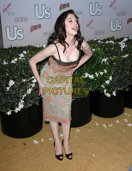 ROSE McGOWAN .The US Hot Hollywood 2007 held at Sugar in Hollywood, California, USA. .April 26th, 2007.full length beige beads beaded dress hands on hips bending leaning cleavage .CAP/DVS.©Debbie VanStory/Capital Pictures