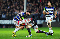 Rob Webber of Bath Rugby is tackled by Sione Kalamafoni of Gloucester Rugby. Aviva Premiership match, between Gloucester Rugby and Bath Rugby on March 26, 2016 at Kingsholm Stadium in Gloucester, England. Photo by: Patrick Khachfe / Onside Images