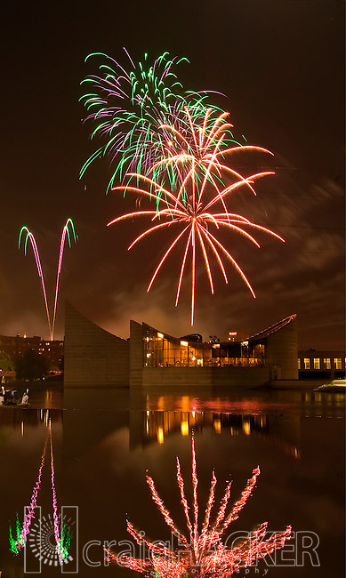 Fireworks explode over Wichita's Exploration Place and the Arkansas River during the annual Wichita River Festival. Craig Hacker.