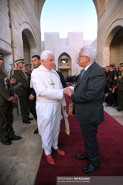 Palestinan President Mahmoud Abbas, walks with Pope Benedict XVI, left, during a welcoming ceremony, at the Palestinian headquarters, in the West Bank town of Bethlehem, Wednesday, May 13, 2009.