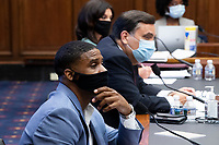 US Navy veteran and Black Lives Matter protester Kishon McDonald (L), George Washington University Law School Law Professor Jonathan Turley (C) and Amelia Brace (Back) of Australia's Seven News appear before the US House Natural Resources Committee hearing on 'The US Park Police Attack on Peaceful Protesters at Lafayette Square', on Capitol Hill in Washington, DC, USA, 29 June 2020. The death of George Floyd while in Minneapolis police custody has sparked protests demanding policing reform and racial equality. Amidst protests authorities cleared Lafayette Square, 01 June 2020, before US President Donald J. Trump walked across the park and visited St. John's Church.<br /> Credit: Michael Reynolds / Pool via CNP / MediaPunch