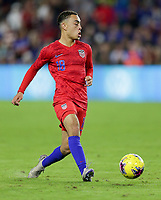 ORLANDO, FL - NOVEMBER 15: Sergino Dest #18 of the United States passes off the ball during a game between Canada and USMNT at Exploria Stadium on November 15, 2019 in Orlando, Florida.