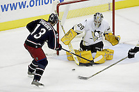 11 January 2006: Pittsburgh Penguins' Marc-Andre Fleury (29) makes a save against Columbus Blue Jackets' Nikolai Zherdev at Nationwide Arena in Columbus, Ohio.<br />