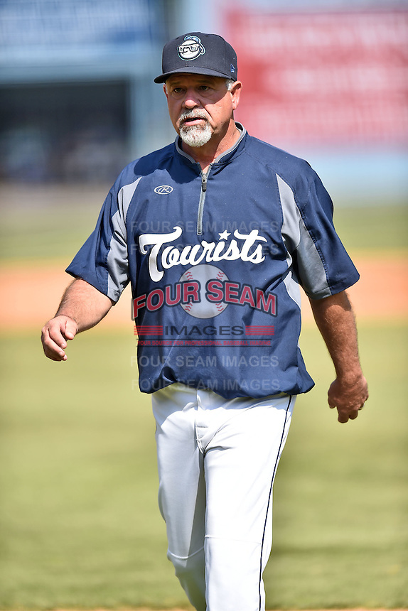 Asheville Tourists pitching coach Mark Brewer (8) during a game against the Lexington Legends on May 3, 2015 in Asheville, North Carolina. The Legends defeated the Tourists 6-3. (Tony Farlow/Four Seam Images)