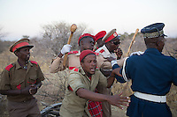 OTJIWARONGO, NAMBIA- AUGUST 12: Herero men dressed in military uniforms, rehearse before a parade when commemorating fallen chiefs killed in battles with Germans. The area was the venue for decisive battles of the Herero uprisings in 1904.  The Herero accuse the German Empire of Genocide of its people from 1904-07. They are currently trying to make the German government compensate the descendants of the people killed. (Photo by Per-Anders Pettersson)