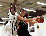 Naugatuck, CT-29 December 2011-122911CM13- Pomperaug's Lucien Fortier is fouled by Naugatuck's Husani Foote as he makes his way to the hoop during a non-league match-up in Naugatuck Thursday night.  Pomperaug was too tough for Naugy and took home the win, 67-57.   Christopher Massa Republican-American