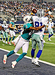 Dallas Cowboys wide receiver Danny Coale (81) and Miami Dolphins defensive back Nolan Carroll (28) in action during the pre- season game between the Miami Dolphins and the Dallas Cowboys at the Cowboys Stadium in Arlington, Texas. Dallas defeats  Miami 30 to 13..