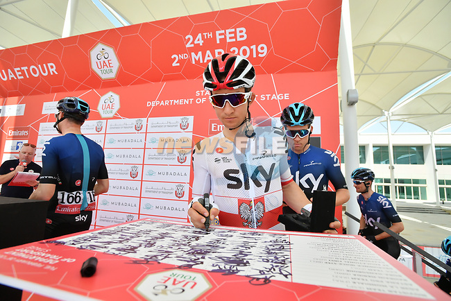 Polish National Champion Michal Kwiatkowski (POL) Team Sky signs on before the start of Stage 3 of the 2019 UAE Tour, running 179km form Al Ain to Jebel Hafeet, Abu Dhabi, United Arab Emirates. 26th February 2019.<br /> Picture: LaPresse/Massimo Paolone | Cyclefile<br /> <br /> <br /> All photos usage must carry mandatory copyright credit (© Cyclefile | LaPresse/Massimo Paolone)