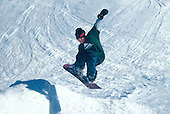 Boy snowboarding in the Upper Peninsula of Michigan.