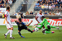 DC United goalkeeper Bill Hamid (28) makes a save on Jack McInerney (9) of the Philadelphia Union during a Major League Soccer (MLS) match at PPL Park in Chester, PA, on June 16, 2012.