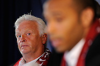 New York Red Bulls head coach Hans Backe listens to Thierry Henry during a New York Red Bulls press conference at Red Bull Arena in Harrison, NJ, on July 15, 2010.