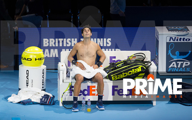 Rafael 'Rafa' NADAL (Spain) looks to the sky as he changes his shirt during the NITTO ATP World Tour Finals match between RAFAEL NADAL and David Goffin at the O2, London, England on 13 November 2017. Photo by Andy Rowland.