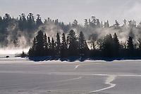 Fog rising  on frozen Lake of the Woods<br />Kenora District<br />Ontario<br />Canada