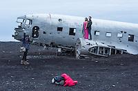Wreck of a Douglas R4D-8 / Super DC-3 at the beach of Solheimasandur.<br /> The airplane of the US-Navy make a forced landing 21.11.1973.<br /> Here: A couple is posing for Honey Moon-pictures.<br /> Wrack einer Douglas R4D-8 vom Typ Super DC-3 am Strand von Solheimasandur in Island.<br /> Die Maschine der US-Navy ist wegen Spirtmangel am 21. November 1973 am Strand von Solheimasandur notgelandet. Mittlerweile ist nur noch ein Teil des Rumpfes vorhanden.<br /> Im Bild: Ein Paar laesst sich in seinen Flitterwochen fotografieren.<br /> 17.3.2016, Solheimasandur<br /> Copyright: Christian-Ditsch.de<br /> [Inhaltsveraendernde Manipulation des Fotos nur nach ausdruecklicher Genehmigung des Fotografen. Vereinbarungen ueber Abtretung von Persoenlichkeitsrechten/Model Release der abgebildeten Person/Personen liegen nicht vor. NO MODEL RELEASE! Nur fuer Redaktionelle Zwecke. Don't publish without copyright Christian-Ditsch.de, Veroeffentlichung nur mit Fotografennennung, sowie gegen Honorar, MwSt. und Beleg. Konto: I N G - D i B a, IBAN DE58500105175400192269, BIC INGDDEFFXXX, Kontakt: post@christian-ditsch.de<br /> Bei der Bearbeitung der Dateiinformationen darf die Urheberkennzeichnung in den EXIF- und  IPTC-Daten nicht entfernt werden, diese sind in digitalen Medien nach &sect;95c UrhG rechtlich geschuetzt. Der Urhebervermerk wird gemaess &sect;13 UrhG verlangt.]