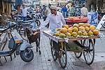 Papaya seller & goat, Mumbai, India