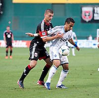 Perry Kitchen (23) of D.C. United fights for the ball with Camilo Sanvezzo (7) of the Vancouver Whitecaps during a Major League Soccer match at RFK Stadium in Washington, DC. D.C. United lost to the Vancouver Whitecaps, 1-0.