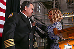 Carson City Fire Chief Bob Schreihans receives his chief's badge from his wife Nancy during a promotional ceremony at Station 51 in Carson City, Nev., on Tuesday, Feb. 3, 2015. Schreihans, who is the fifth paid chief in the history of the department, has been with CCFD for nearly 31 years.<br /> Photo by Cathleen Allison/Nevada Photo Source