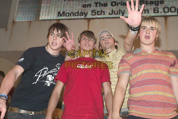 McFLY.At Trafford Centre Manchester free concert. Then Record signing..July 5th, 2004.half length, music, band, group, gesture.www.capitalpictures.com.sales@capitalpictures.com.© Capital Pictures.