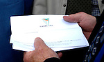 12-6-07 Killarney: You can look but you cannot see..... Brandishing the Taosieach signed document worth millions of euro to South Kerry, Deputy Jackie Healy-Rae proudly fulfills his promise to his constituents in Killarney on Tuesday.<br /> Picture by Don MacMonagle