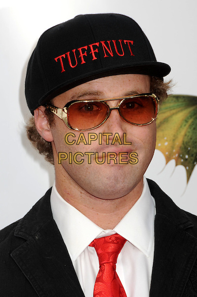 "T.J. MILLER .""How To Train Your Dragon"" Los Angeles Premiere held at the Gibson Amphitheatre, Universal City, California, USA, 21st March 2010..arrivals portrait headshot red tie sunglasses Tuffnut slogan cap hat black .CAP/ADM/BP.©Byron Purvis/AdMedia/Capital Pictures."