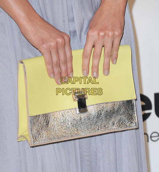 Debby Ryan's bag.The 21st Annual Elton John AIDS Foundation Academy Awards Viewing Party held at The City of West Hollywood Park in West Hollywood, California, USA..February 24th, 2013.oscars hands detail blue sheer silver yellow clutch bag nude nail varnish polish.CAP/DVS.©DVS/Capital Pictures.