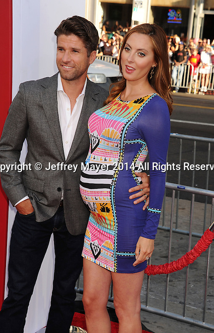 HOLLYWOOD, CA- JUNE 30: Actress Eva Amurri Martino (R) and husband Kyle Martino arrive at the 'Tammy' - Los Angeles Premiere at TCL Chinese Theatre on June 30, 2014 in Hollywood, California.
